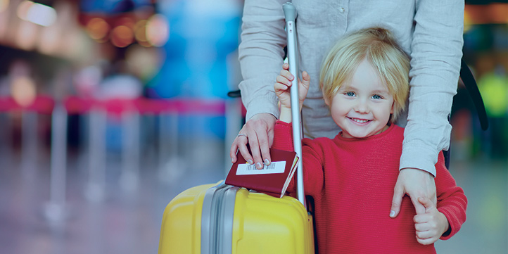 photo of boy with luggage