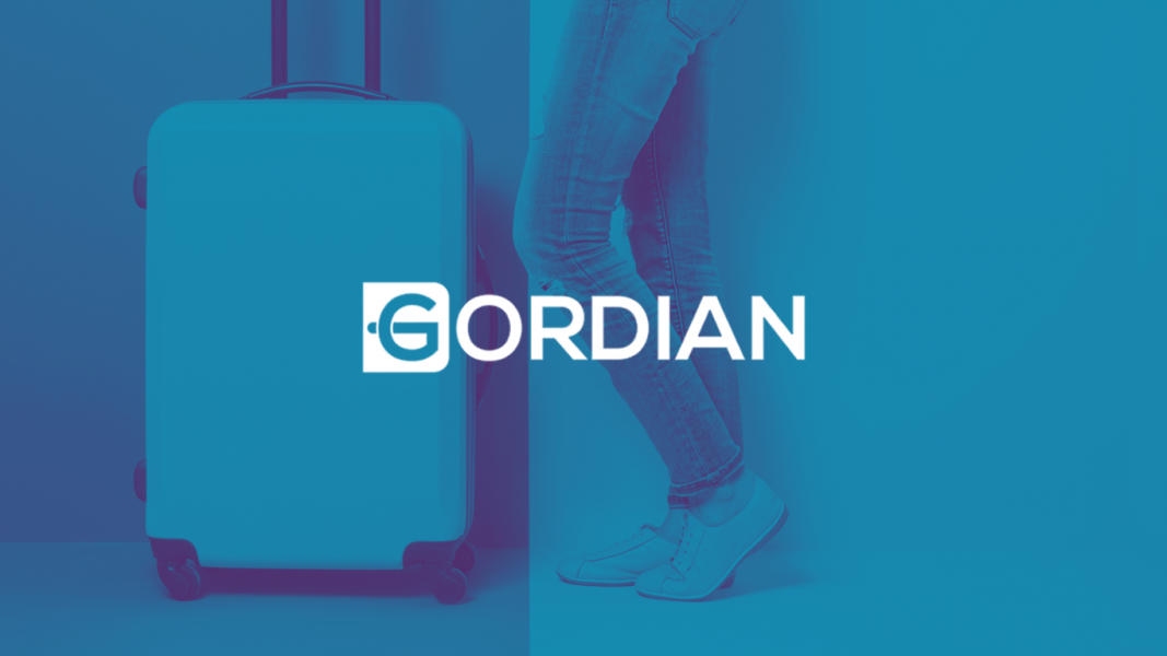gordian logo on blue background of a person standing with luggage