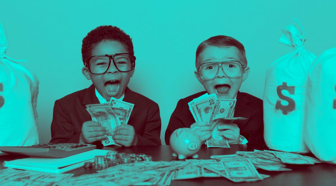 two kids holding money
